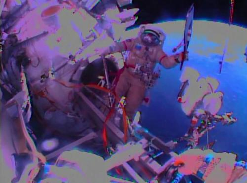 Russians take Olympic torch on first-ever spacewalk