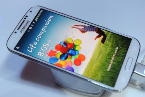 Samsung's new Galaxy S4 is seen during its unveiling in this March 14, 2013 file photo at Radio City Music Hall in New York