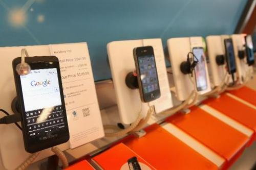 Smartphones are on display at an AT&T store in Chicago, Illinois, March 28, 2013