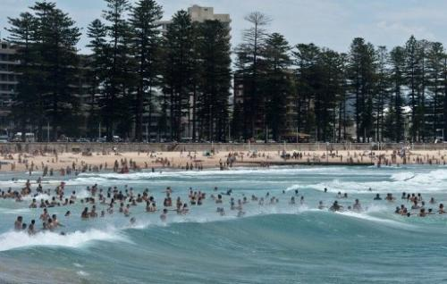 Sydneysiders and tourists cool off in the sea at Manly beach in Sydney, on January 8, 2013