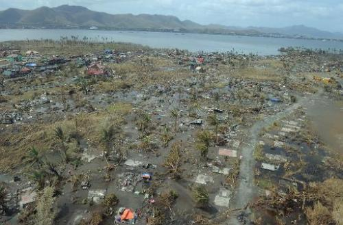 This aerial photo shows a devastated area in the city of Tacloban, Leyte province, in the central Philippines on November 11, 20