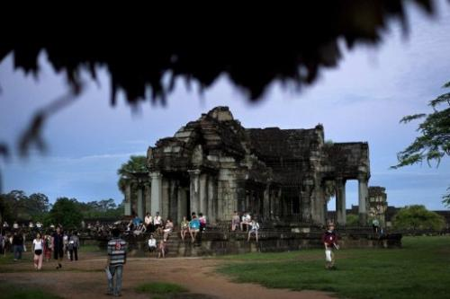 Tourists visit Angkor Wat temple during sunrise in Siem Reap, Cambodia, on July 14, 2012