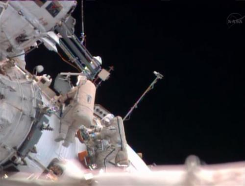 2 Russians take spacewalk outside space station