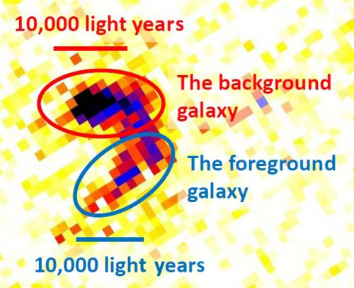 Gravitational lensing in the peculiar 'magatama' galaxy