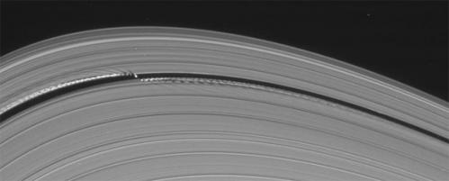 Saturn's little wavemaking moon