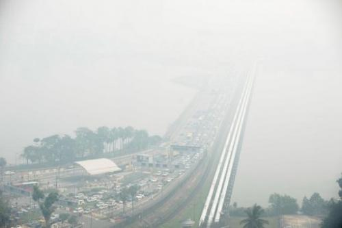 A general view of the causeway from Singapore to Johor Bahru (background), obscured by thick haze, on June 21, 2013