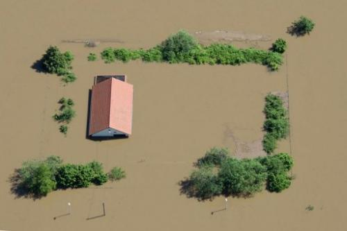 An aerial view shows a flooded house near Meissen, eastern Germany on June 5, 2013