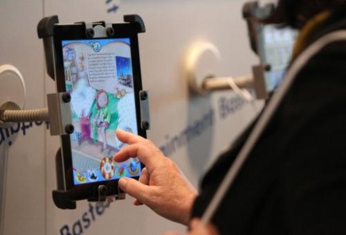 A visitor looks at a e-book for children at the 64th Frankfurt Book Fair in Germany, on October 10, 2012