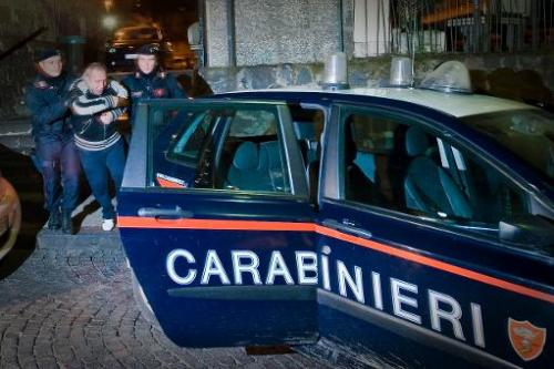 File photo shows Italian Carabinieri arresting a suspect in Naples on January 25, 2011