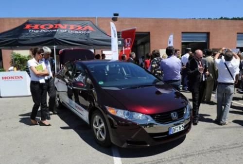 People look at a Honda's FCX Clarity hydrogen fuel-cell car, on July 7, 2010 in Ales, France