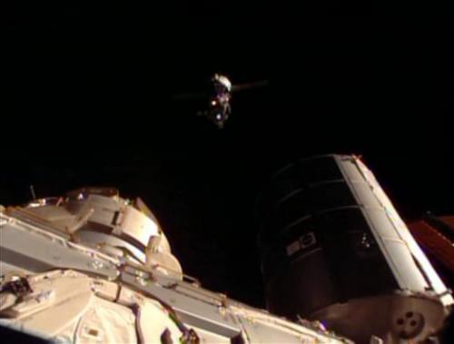 Soyuz capsule docks with space station