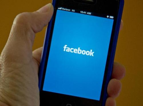 An Apple iPhone displays the Facebook app's splash screen on May 10, 2012 in Washington, DC