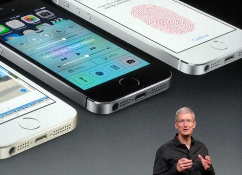 Apple chief executive Tim Cook praises the new iPhone 5S as the most refined model the company has ever introduced on September