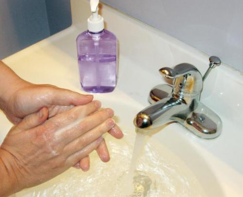 Person washes their hands with an antibacterial soap. credit: john