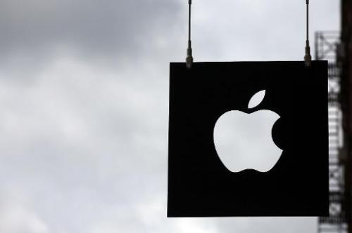 The Apple logo hangs in front of an Apple store on July 23, 2013 in New York City