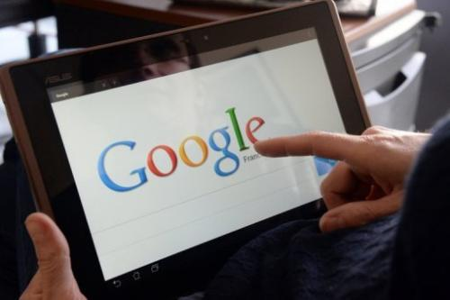 File picture shows a woman using Google on her tablet