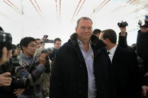 Google Executive Chairman Eric Schmidt (C) makes his way past the media at Beijing International airport January 7, 2013