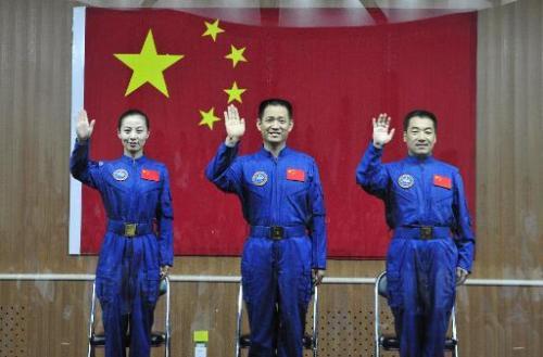 Image taken on June 10, 2013 shows crew members of Shenzhou-10 (L-R) Wang Yaping, Nie Haisheng and Zhang Xiaoguang at a press co