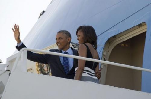 US President Barack Obama and First Lady Michelle Obama board Air Force One at Andrews Air Force Base, on June 26, 2013