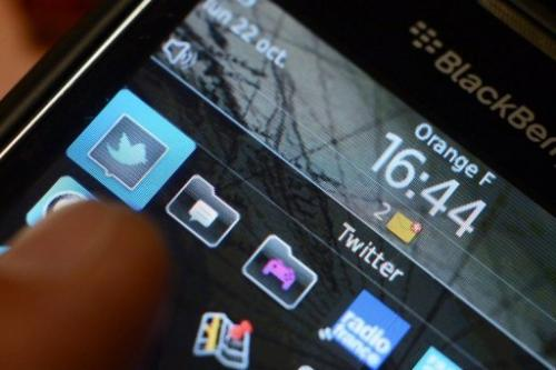 A blackberry phone showing a page of the micro-blogging site Twitter on October 22, 2012 in Rennes, France.
