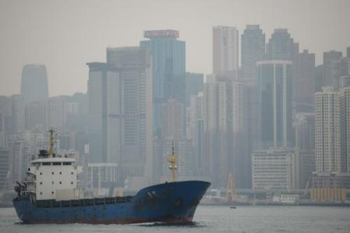 A boat enters the Victoria Harbour on January 10, 2013 as a haze of pollution shrouds the Hong Kong's skyline