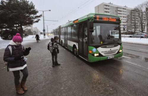 A bus stops for passengers in Tallinn on January 9, 2013