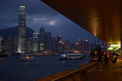 A ferry crosses Victoria Harbour in front of the Hong Kong skyline on October 19, 2012