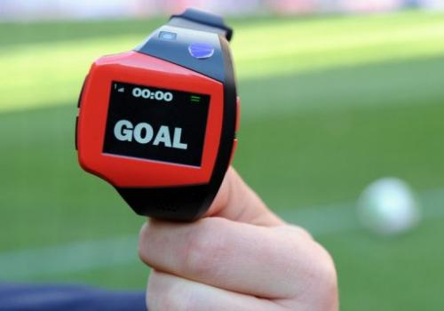 A FIFA officer displays a watch during a demonstration of goal-line technology in Tokyo on December 8, 2012