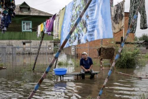 A flooded street in Bolshoi Ussuriysky near Khabarovsk in Russia's Far Eastern Amur region, on August 19, 2013