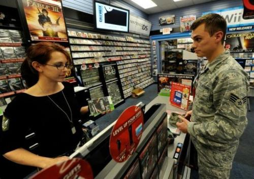 A man buys a video game at a GameStop store on November 9, 2010 in North Las Vegas, Nevada