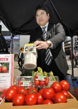 A man checks vegetables for radiation on April 12, 2011