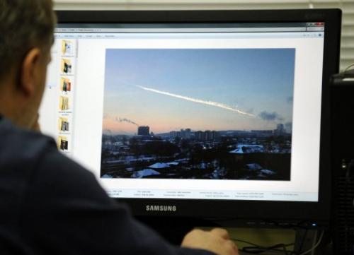 A man in Moscow looks at a computer screen on February 15, 2013, showing the trail of a meteorite