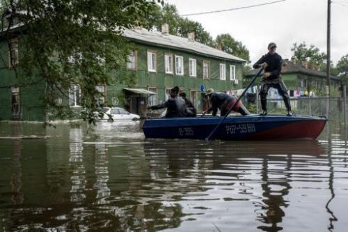 A man paddles a boat down a flooded street near Khabarovsk in Russia's Amur region, August 20, 2013