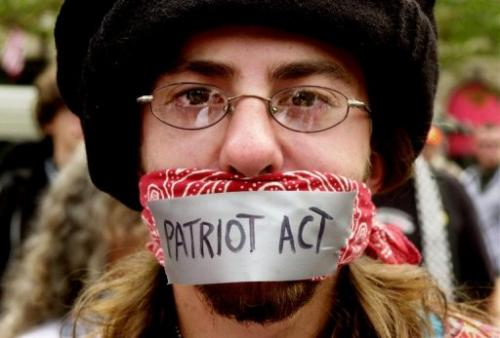 A man protests the Patriot Act on July 29, 2004 in Boston, Massachusetts
