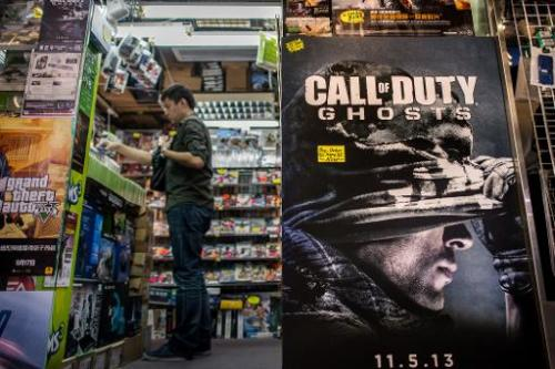 A man stands at the counter of a games shop in Hong Kong on November 4, 2013