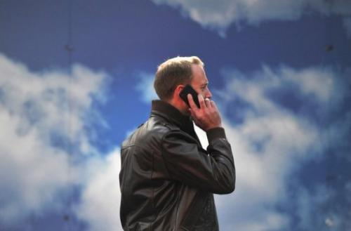 A man talks on a smartphone in central London on October 17, 2012