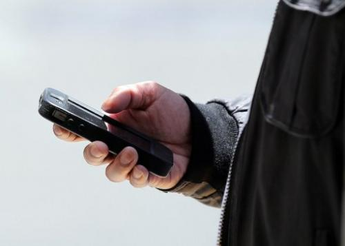 A man uses a smartphone on June 5, 2013 in San Francisco, California