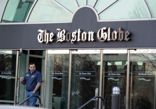 A man walks out of The Boston Globe on February 20, 2013 in Boston, Massachusetts