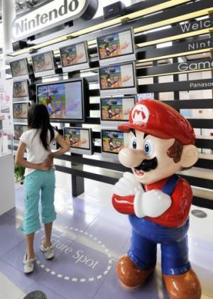 A mascot of Nintendo's popular game character Super-Mario standing at a showroom in Tokyo on July 30, 2008