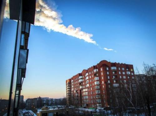 A meteorite trail is seen above a residential apartment block in the Urals' city of Chelyabinsk, on February 15, 2013