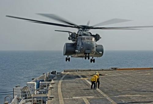 A MH53E helicopter takes off from the USS Ponce to conduct a mine clearance exercise in the Gulf on September 24, 2012