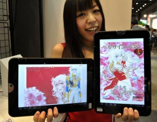 A model displays a tablet PC as an book reader, equipped with Google's Android OS, in Tokyo, on July 7, 2011