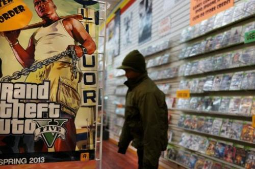 An advertisement for the new Grand Theft Auto is viewed at a gaming store on January 11, 2013 in New York City