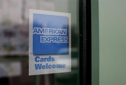 An  American Express sign is shown in the window of a restaurant November 11, 2008 in Des Plaines, Illinois