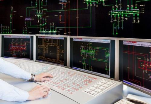 An Amprion employee watches a board displaying the electrical network at the power operator in Pulheim, on May 14, 2013