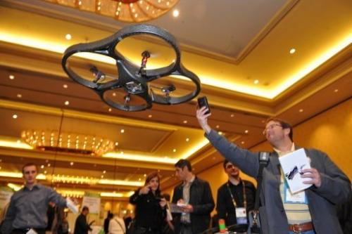 An A.R. Drone helicopter by Parrot flies overhead at an electronics show on January 6, 2010 in Las Vegas, Nevada