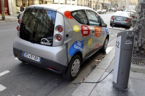 An Autolib electric bluecar plugged at a charging station in Paris on December 2, 2011