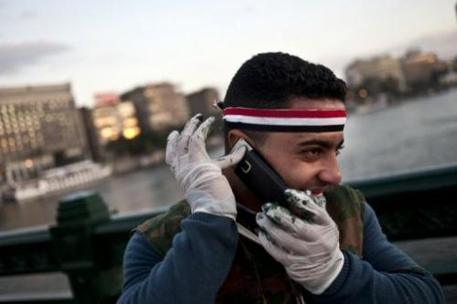 An Egyptian talks on his phone in Cairo on February 16, 2011