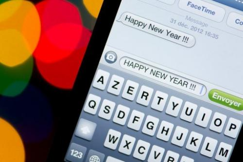 A New Year text message is pictured on a smartphone on December 31, 2012 in Paris