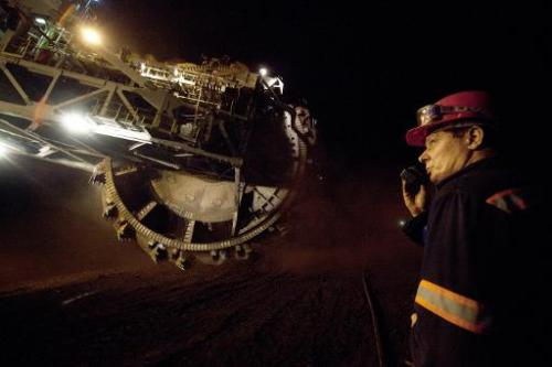 An excavator works in a open-cast mine in Belchatow, central Poland, on September 28, 2011